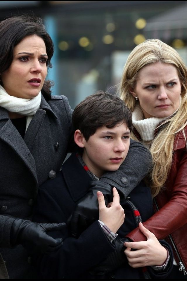 Regina and Emma are holding Henry together to protect Henry from danger.